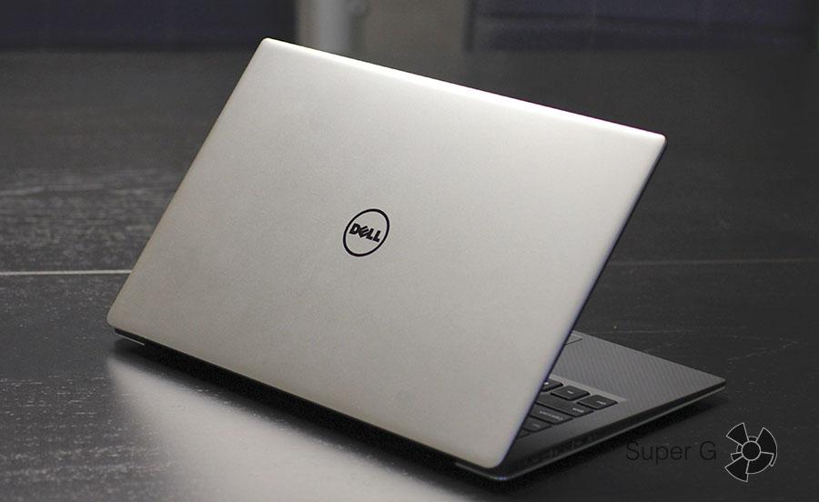 Символ Dell на верхней крышке