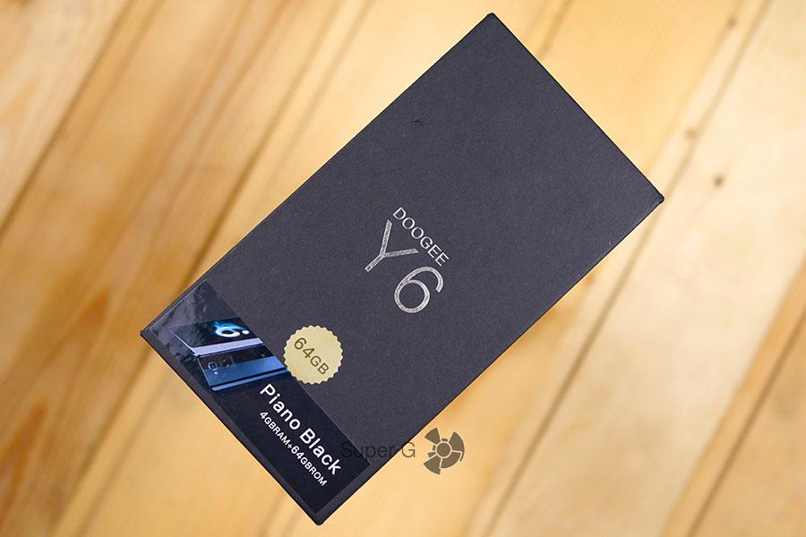 Коробка из-под Dogee Y6 Piano Black - распаковка
